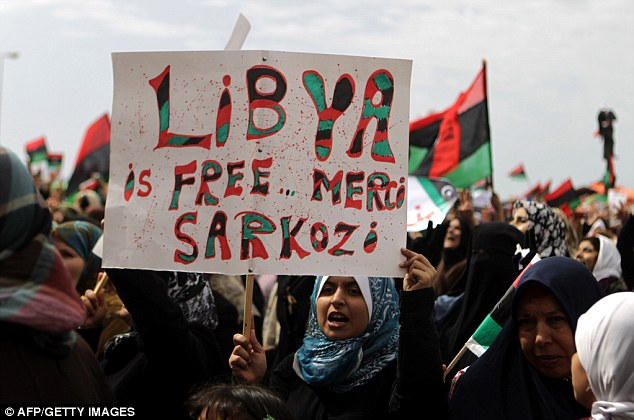 Thanks: A Libyan woman holds a placard hailing French President Nicolas Sarkozy after a UN vote, led by France and Britain, approved a no-fly zone
