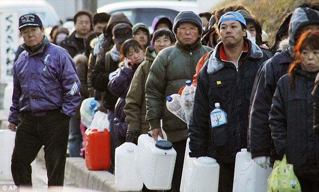 Long lines and short supplies: People stand in line to wait for water in Ishinomaki in the north of Japan