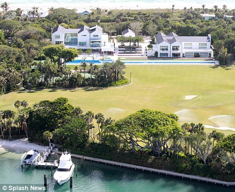 Bachelor pad: Tiger is preparing to move into his new $60million Florida mansion which can be a love nest for him and his new girlfriend - it has a four-hole golf course and a dock for his yacht