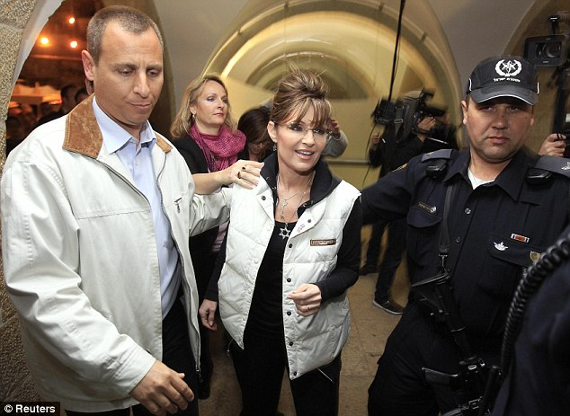 Solidarity: Sarah Palin arrives at the Western Wall tunnels in Jerusalen's Old City this afternoon wearing a Star of David necklace
