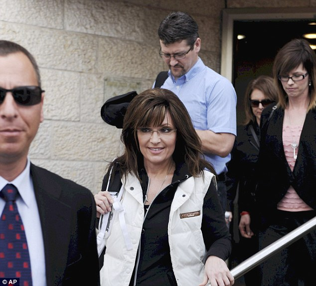 Visit: Mrs Palin, followed by her husband Todd, arrives at Ben Gurion airport earlier today