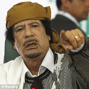 Threats: David Cameron warns Colonel Gaddafi may seek to return to his former status as the world's foremost terrorist paymaster
