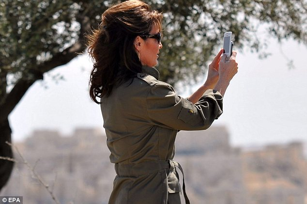 Site seeing: The former Alaska governor tried to keep a low profile away from the media glare during her trip but was happy to snap away at the scenery with her camera phone