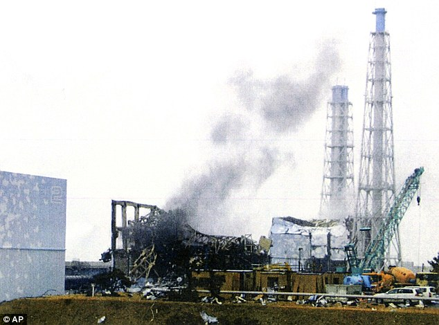 Alarm: Black smoke rises from the Number 3 reactor at Fukushima Dai-ichi nuclear power plant after staff were evacuated this morning