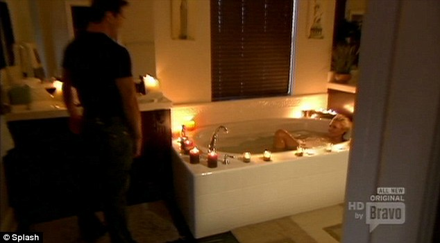 Hot stuff: At least there was plenty of water around in case one of the candles set light to the bathroom