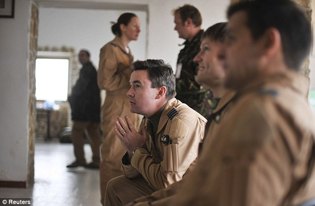 Awaiting instructions: RAF pilots prepare for their mission at the new advanced airbase at Giola Del Colle  in Italy