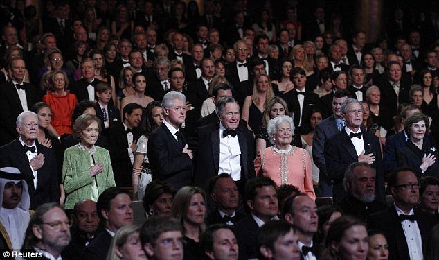 Imagine the security arrangements... : Former U.S. Presidents Bill Clinton (3rd L), Jimmy Carter (L), George. H.W. Bush (C) and George W. Bush (2nd R) at this week's event