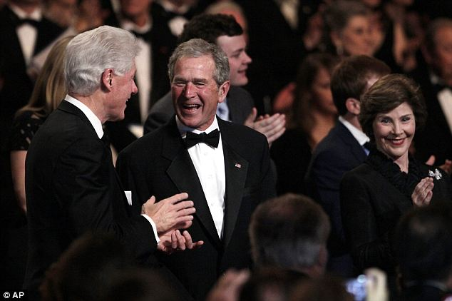 Former President Bill Clinton, left, shares a joke with his successor in the White House, George W Bush