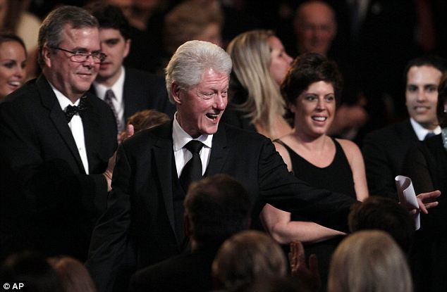 Charismatic Clinton: The ex-president has a familiar twinkle in his eye as he greets well-wishers at the Washington DC event