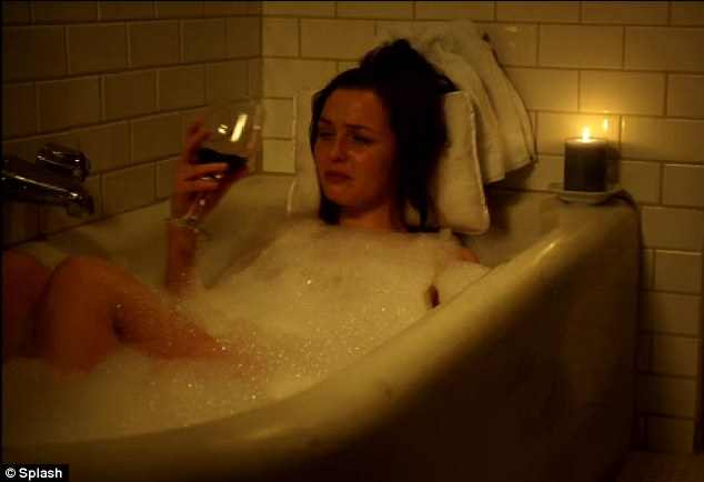 Too corny: A scene from the U.S. film William and Kate, the royal bride-to-be is shown in a bath tub drinking a glass of wine and crying - a shot that could have been taken from the latest rom com film