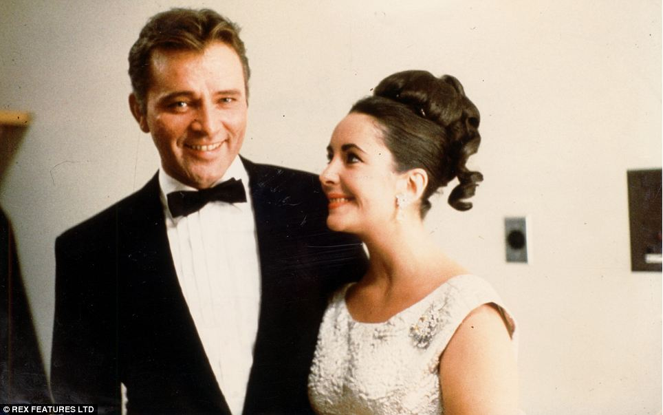 Look of love: Elizabeth, pictured with her fifth husband, Richard Burton, whom she was married to from 1964-74 - and again from 1975-76