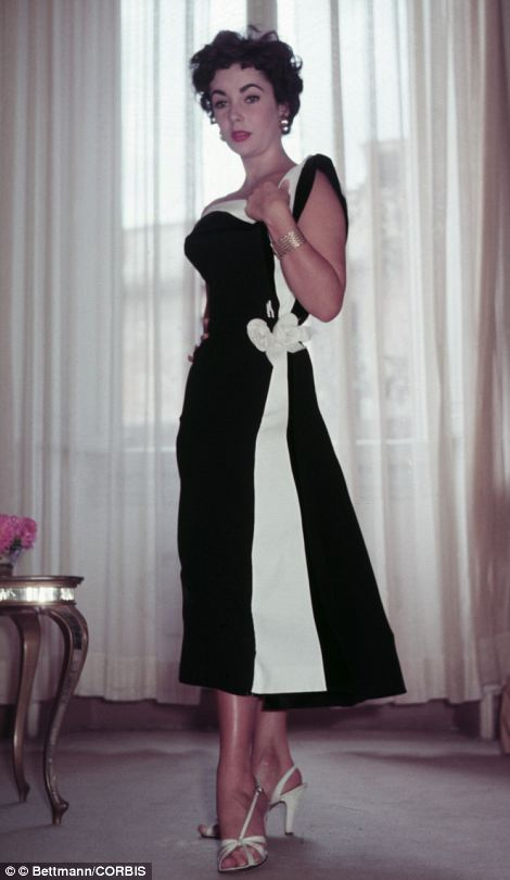 Fashionable: Elizabeth Taylor visits famed dressmakers the Fontana Sisters on a visit to Rome in 1953 and tries on a cocktail frock in black and white silk