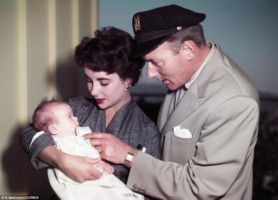 Proud mother: Elizabeth Taylor with second husband Michael Wilding and baby Michael Jr in 1953