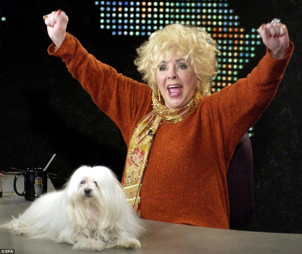 Blonde bombshell: Elizabeth Taylor on CNN's Larry King Live with her beloved dog in 2003