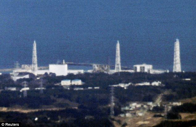 An aerial view shows Fukushima Daiichi nuclear power plant in Fukushima. Reactors 1 to 4 are seen from L to R in this picture taken from more than 40km (25 miles) away
