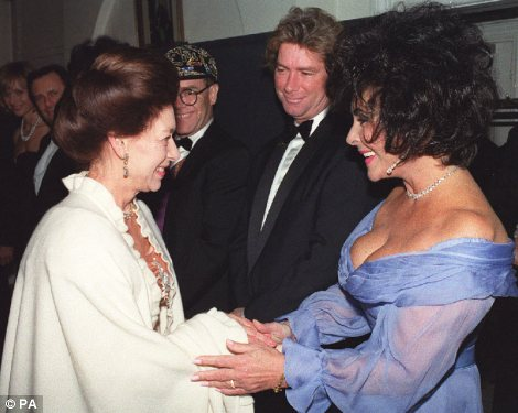 From pop royalty to real royalty: Taylor with Madonna in 1997 (left) and greeting Princess Margaret in 1991