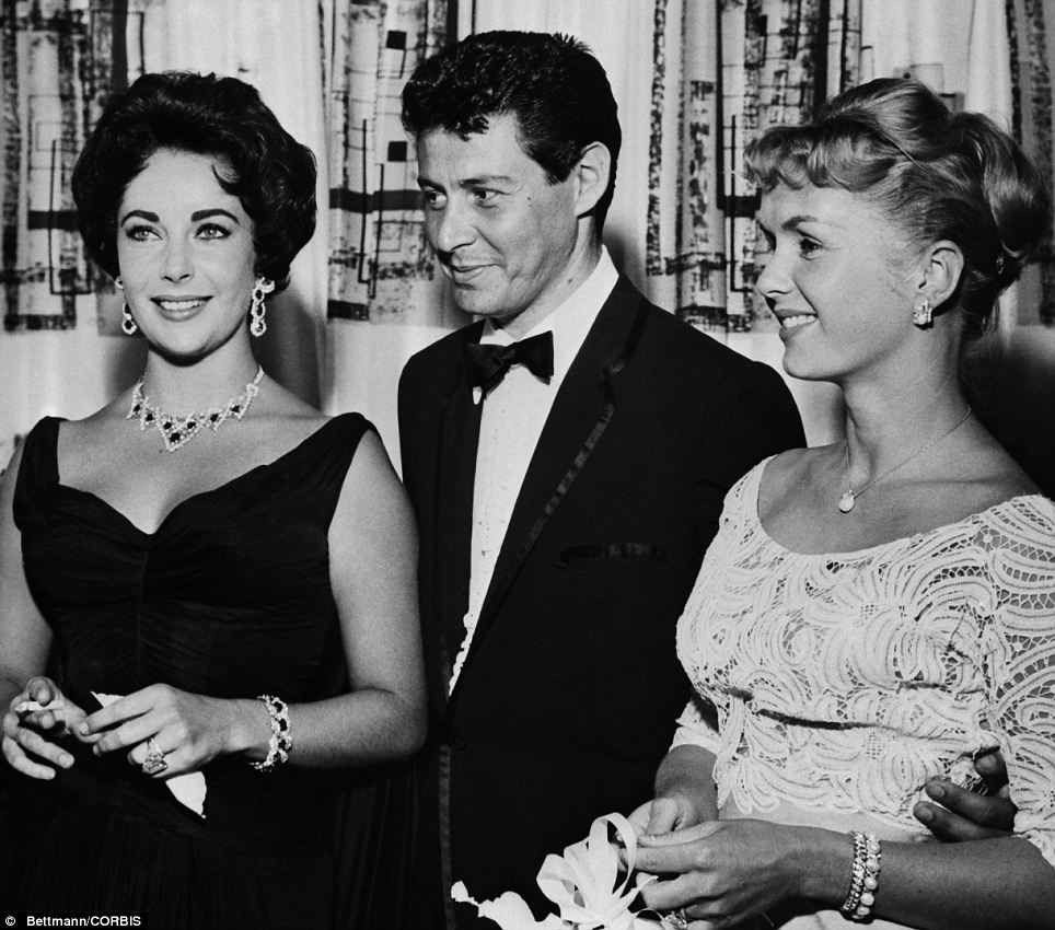 Husband swap: Taylor with Eddie Fisher and his then-wife Debbie Reynolds at the Tropicana Hotel in Las Vegas in 1958