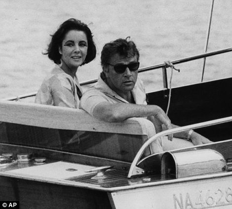 Jet-setting: Taylor and Burton on a boat at the isle of Ischia in southern Italy in 1962