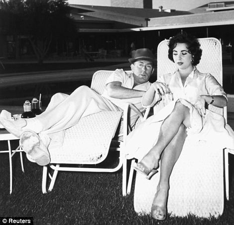 Laidback: Taylor and second husband Michael Wilding relax in the grounds of the Sahara Hotel in Las Vegas in 1956