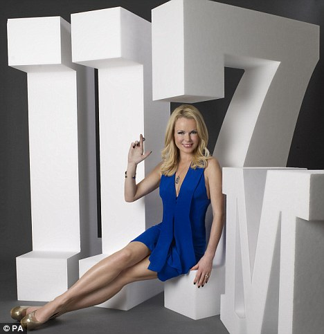 Fingers crossed: Amanda crosses her fingers while sitting on a prop for £117m to promote the lottery