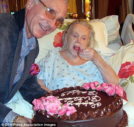 Ailing: Gabor was in hospital last month, seen here being  presented with a cake by her husband of 25 years Prince Frederic von Anhalt for her 94th birthday