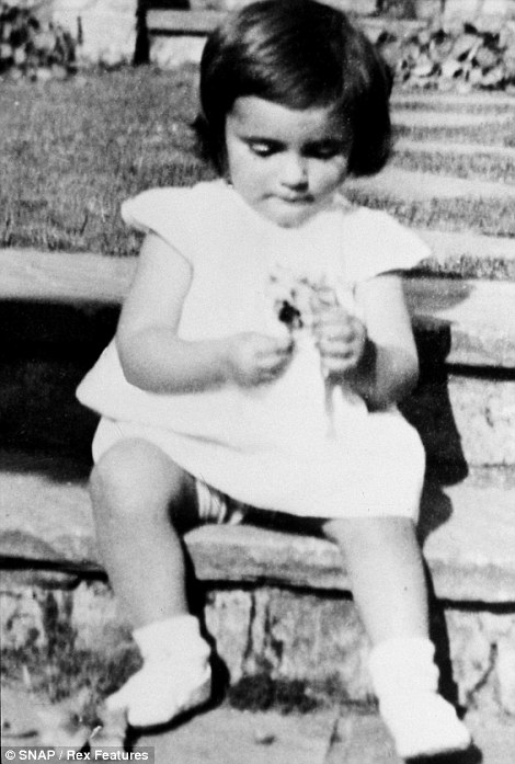 In 1934: Elizabeth, aged two, on the steps of her family home in London