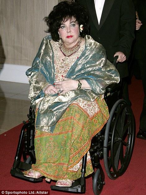 Wheelchair bound: Liz attends an awards ceremony