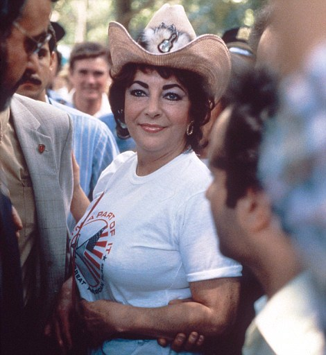Hey, cowgirl: Liz turned 50 in 1982... and divorced yet again