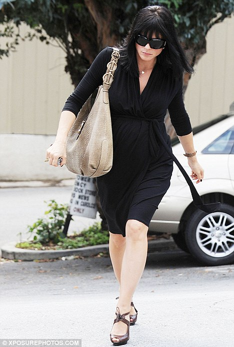 Formal: Meanwhile, pregnant actress Selma Blair dressed to kill in a black dress in West Hollywood today