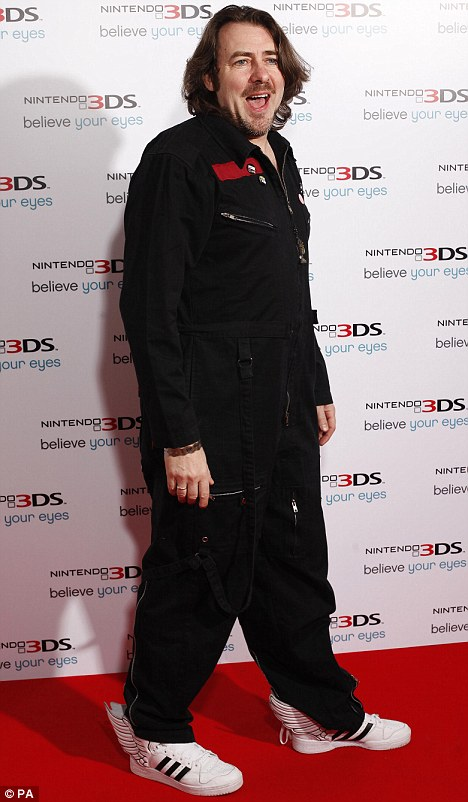 Getting down with the kids: Jonathan Ross arrives at the Nintendo 3DS launch in London in a boiler suit and winged trainers