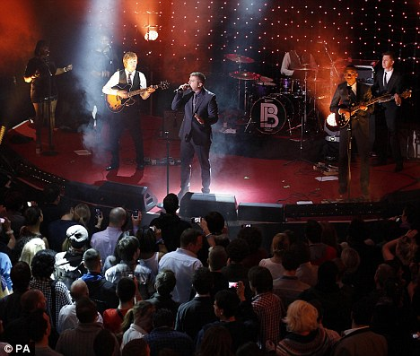 Spectacle: Brit Award winner Plan B performed as the partygoers counted down to the midnight launch of the new console