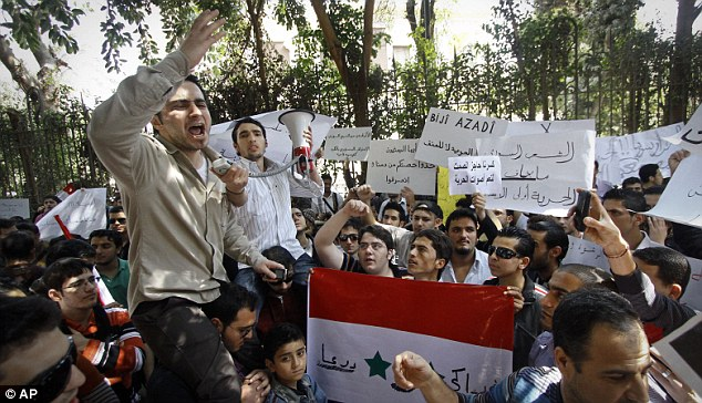 Protest: Around one hundred Syrians living in Egypt demonstrate against the Syrian government and in support of protesters outside the Syrian embassy in Cairo