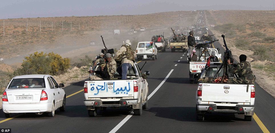 Libyan rebels vehicles pack the road between between Ras Lanouf and Sirte in eastern Libya
