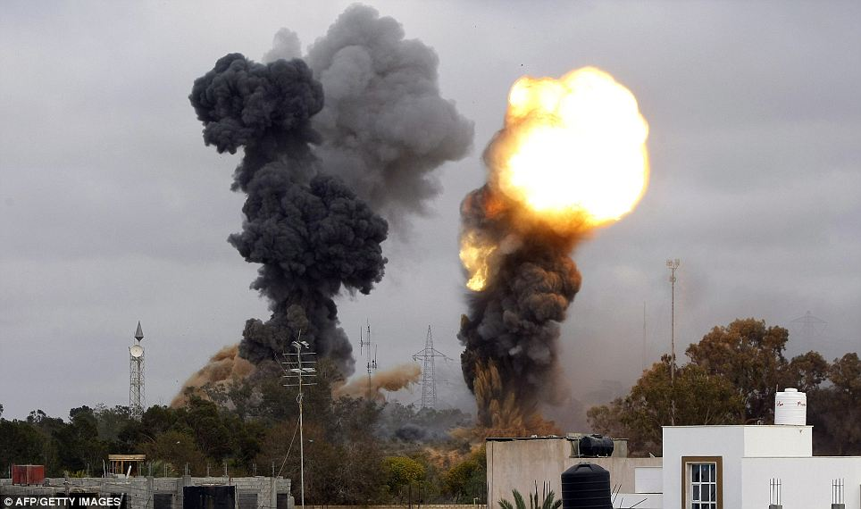 Smoke billows as seven explosions were reported in the tightly-guarded residence of leader Gaddafi and other targets in the Libyan capital Tripoli