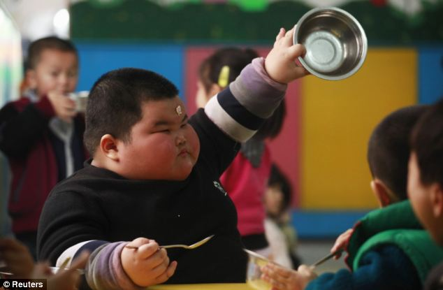 More please: Hao, with a piece of food apparently stuck to his face, demands an extra serving during kindergarten class
