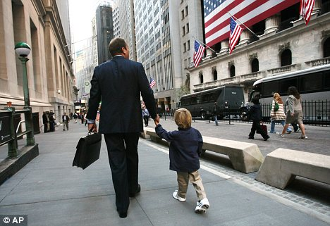 Family vibe: A father walks his son to school in the financial district. Grocery stores have opened and three new schools have opened up in four years in the area