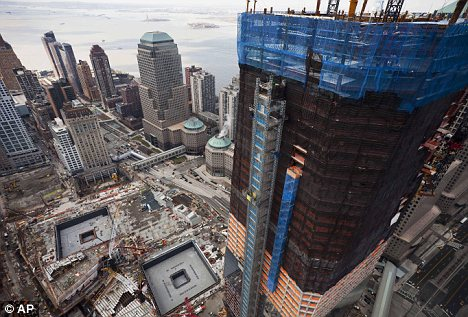 New life: The Freedom Tower, right, rises above the World Trade Centre site in New York