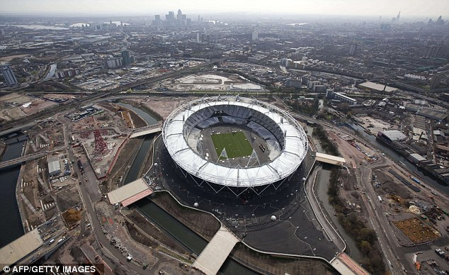 Green for go: The Olympic Stadium is complete... but finances post-Games are still being argued over