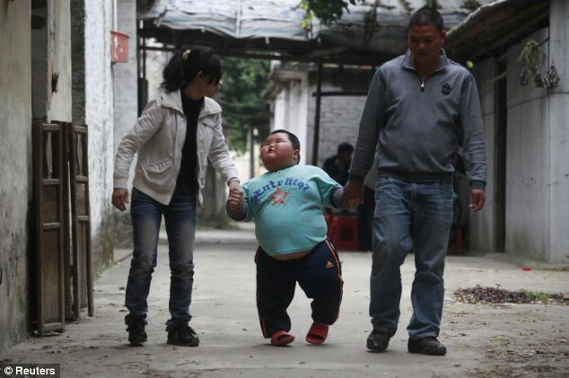 Hao strolls near his home with his mother Chen Yuan, left and father Lu Yuncheng