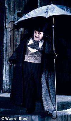 Inspiration?: President Sarkozy's security measure is reminiscent of the bullet and gas-firing equivalent used by the Penguin (Danny DeVito) in Batman Returns