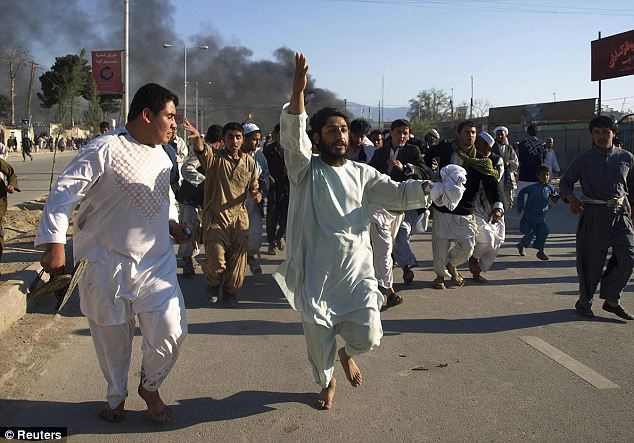 Suspects: Afghan officials suspect those who attacked the base were insurgents who had blended into the angry crowd before carrying out the violence
