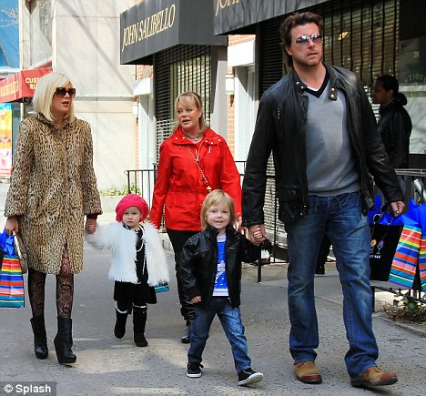Family day out: Tori was also joined on the shopping trip by her husband Dean McDermott and four-year-old son Liam