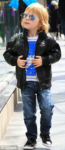 Just like dad: Liam wore jeans and a black leather jacket with dark sunglasses