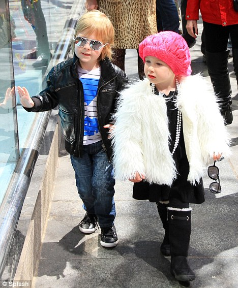 Brother-sister love: The siblings were on best behaviour and looked adorable during their day out