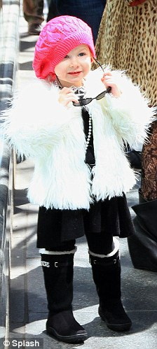 Stellar look: Little Stella looked like a budding fashionista and wore a black dress, black fur-lined boots and a fluffy white jacket