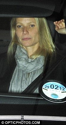 Why so sjhy? Gwyneth Paltrow hides under her silk scarf while out with Matthew Morrison in London
