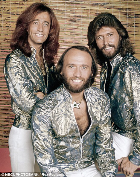 Disco heyday: Robin (l) in the 1970s with his fellow Bee Gees, his late twin Maurice (c) and Barry (r)