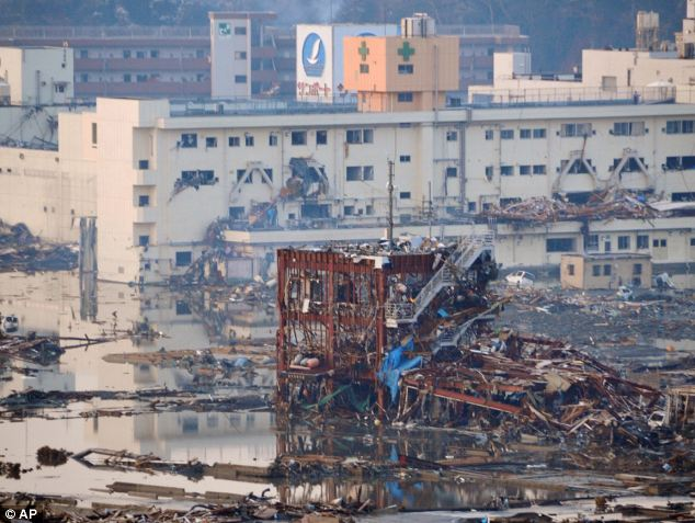 Alive: the terrified survivors cling to the decimated skeleton of the building