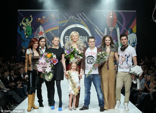 What a finale: Anna Chapman poses on the runway with the designers at the end of the Shiyan & Rudkovskaya show