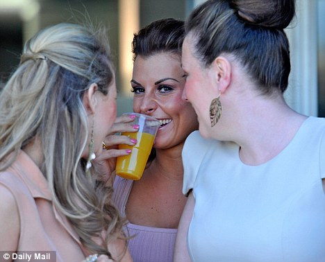 Ladies' day: Coleen Rooney was also at Aintree, having a giggle with her girlfriends
